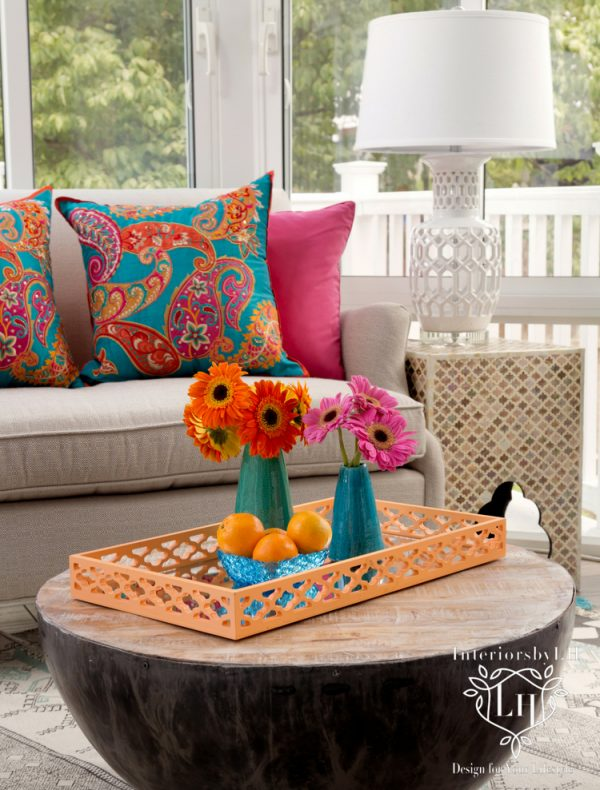Interior Design - bright sunroom accent table with lamp, flowers, and bright pillows
