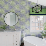 Bathroom with white fixtures and bold patterned wallpaper